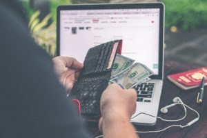 person holding 10 us dollar banknote in front of gray and black laptop computer 300x200 - person-holding-10-us-dollar-banknote-in-front-of-gray-and-black-laptop-computer